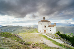 Sanctuary (Simone Della Fornace) Tags: abruzzo italy church mountains green sky clouds moody atmosphere surrounded nopeople copyspace fullframe fulllenght sony a7rii voigtlander 15mm wide wideangle landscape nature calascio travel rock tourism architecture building grass white alone countryside lonely grey hills above