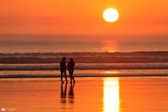 Conversation beach (technodean2000) Tags: sunset girls silhouette porthcawl rest bay south wales uk conversation talking beach sun nikon d610 lightroom sea waves water light golden hour