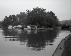 Thames: Eynsham lock (OhDark30) Tags: olympus 35rc 35 rc film 35mm monochrome bw blackandwhite bwfp fomapan 200 rodinal swinford lock eynsham river thames path reflection boats footpath mooring