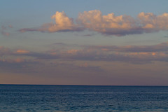 Changing Light - Beach Sunset (brucetopher) Tags: beach water sea ocean coast evening susnet twilight afterglow horizon cloud clouds light sunlight skies sky colorful bluesea blue