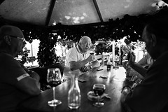 The rounders (Giulio Magnifico) Tags: traditional streetphotography 28mm card orzano wine frasca hand friends friuli cividale rounders wood gazebo fvg old bw italy leicaq street redwine bar blackandwhite detail smoking taglio soulful vintage friulano leica glass osteria