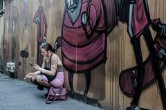 A juego con la pared (F719D) Tags: street streetphotography urban underground graffiti streetart candid cellphone smartphone phone tights run ladder rose purple cigarrette smoke smoking