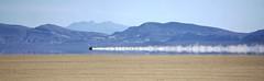 Speeding above ground (PeterThoeny) Tags: blackrockdesert nevada desert lakebed playa reflection car speed dust dustcloud mirage aeropac outdoor 1xp sel55210 nex6 raw photomatix hdr qualityhdr qualityhdrphotography