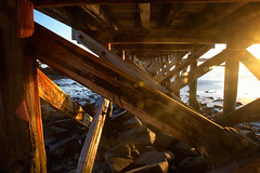 The Light Under the Pier (SunnyDazzled) Tags: golden sunset light wooden pier fortfoster maine kittery point coast coastal beach rocky shore sea ocean vacation