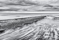 Hendon Beach Mono (robinta) Tags: mono blackwhite monochrome beach sea ocean seaandsand coast wave surf tide blur longexposure hendon sunderland england seascape water pentax sigma sigma18200mmhsmc seashore seaside architecture contrast movement
