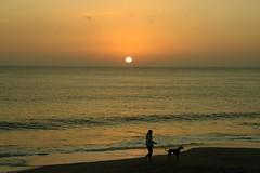 WALKING THE DOG (R. D. SMITH) Tags: sunrise dog beach morning sand walking florida sun atlanticocean outside