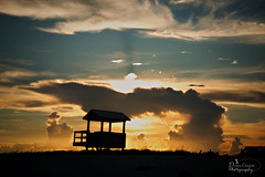 Drama and Peace Mixing (donna.chiofolo) Tags: nature beach sunset sky colors movement clouds sand coast navarre florida emeraldcoast mood atmosphere