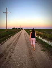 """""""The Long Way Home"""" Down a country road, beside the cottonfields, into a West Texas sunset. One Person The Way Forward Sunset Walking Real People Lifestyles Outdoors Road Scenics Adult People Sky West Texas Sunset Cottonfields West Texas Skies West Texas (bradhodges09) Tags: oneperson thewayforward sunset walking realpeople lifestyles outdoors road scenics adult people sky westtexassunset cottonfields westtexasskies westtexas ruralscene ruralroad countryside countryroads"""