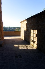 Civita di Bagnoregio (elisecavicchi) Tags: civita di bagnoregio light window glow shadow pattern grid path view distant city late afternoon gold broken panes italy central viterbo lazio dying sunlight