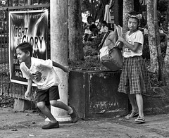 Not Me ! (Beegee49) Tags: boy running girl standing bow silay city philippines