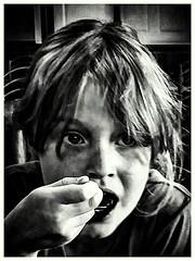 Day 203. (lizzieisdizzy) Tags: blackandwhite monochrome whiteandblack portraiture child female girl young pretty drinking enjoy slush ice iced drink monotone chroma chromatic hand spoon mouth opem tongue