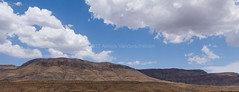 Namibian desertscape. (annick vanderschelden) Tags: namibia hardap naukluft mountains hills sand rocks arid semiarid desert vegetation grasses sky bluesky clouds sunlight hot soil dust bush