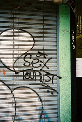 Sex Tourist - Bangkok (35mm) (jcbkk1956) Tags: graffiti street ekkamai shutters film 35mm analog vivitar vivitar35ee rangefinder kodak ultramax400 bangkok thailand sx tourist worldtrekker uc400 texture