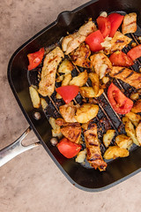 Grilled marinated pork chops with tomatoes and potatoes. (annick vanderschelden) Tags: pork meat slices culinary domestic pic suscrofadomesticus consumed raw cooked fat texture dietary food pig cooking preparedmeat nutrition grill heat temperature honey soysauce shallot garlic turmeric oliveoil salt pepper tomato potato