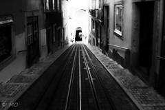At the back of the street (mathieuo1) Tags: portugal lisboa lisbonne blurry unfocus blur blackandwhite black contrast convergence rails street streetphotography straight light shadow dark grey lines shape geometry symmetry building oppression composition saturated europe city capital tramway nikon dlsr architecture ghost travel explore traveler landscape urban focus artistic original test mathieuo
