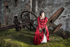 Victorian time traveler (BarryKelly) Tags: cosplay steam punk dress red satin hat cogs industrial silk gun sifi grass old mill wexford