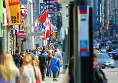 On The Busy Street, I Walk Alone .... (Greg's Southern Ontario (catching Up Slowly)) Tags: yongestreet busystreet traffic torontoist urban city busycitystreet people crowdedstreet