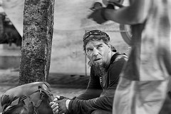 Quiet Observance (Ian Sane) Tags: ian sane images quietobservance man homeless humble facial expression woman passing by black white candid street photography southwest morrison downtown portland oregon canon eos 5ds r camera ef70200mm f28l is usm lens