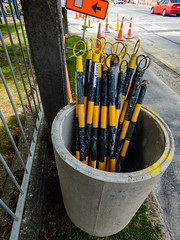 In the Pipeline (Steve Taylor (Photography)) Tags: pipe roadworks sign construction traffic cone bollard road street red orange yellow green concrete metal fence newzealand nz southisland canterbury christchurch cbd city grass lawn car automobile