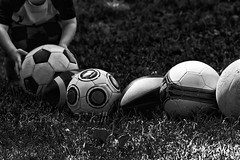 In a Row (LongInt57) Tags: balls soccer football rugby sport play game playing fun child children boy person people row line kelowna bc canada okanagan bw monochrome black white grey gray