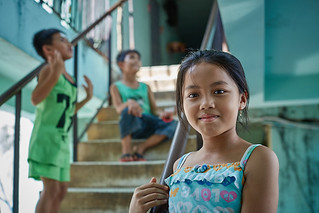 Little Cambodian girl in the stairs, White Building, Phnom Penh, Cambodia