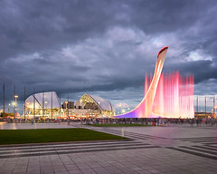 Music Fountain and Olympic Stadium Fisht in the Evening, Sochi, Russia (ansharphoto) Tags: adler architecture arena blue bowl building city cityscape competition design district dusk electric evening fisht flag flagstaff fountain games iconic illuminated imereti imeretinsky krai krasnodar landmark landscape lights modern monument music night olympic resort russia singing sky skyline sochi sport sports stadium tourism town travel twilight urban vacation view village