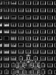 Dark windows (felipe_gabaldon) Tags: geometry architecture blackandwhite lines windows geometric architectur3 lowkey angles modern skyscrapper floors symetry buiding tallbuilding urban spain madrid edificioespaña granvía