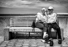 A shoulder to lean on. (Mister G.C.) Tags: street urban photography blackandwhite bw germany ricoh ricohgr streetphotography urbanphotography candid shot image photograph people bench seat sunglasses shades elderly monochrome town city zonefocus zonefocusing snapfocus pointshoot mistergc schwarzweiss strassenfotografie niedersachsen lowersaxony deutschland europe
