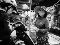 Saigon 36 (arsamie) Tags: saigon vietnam hcmc asia phu nhuan woman stripes hat black white motorbike gas mask pollution sun bills dong million trade buy sell morning market