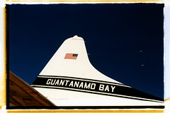 Guantanamo Bay (tobysx70) Tags: nikon f2 photomic kodak ektachrome lumiere 100 professional 35mm 135 color slide film 5046 lpp crossprocessed xpro sloppy borders rollfilmweek july 2017 guantanamo bay pima air space museum tucson arizona az convair c131 cargo plane airplane aircraft tail tailplane military navy us flag star stripes blue sky cuba day2 toby hancock photography
