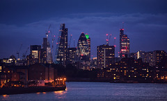 London Skyline (Florian Bütow) Tags: sky city sunset water downtown river travel urban architecture cityscape building london evening skyline skyscraper office waterfront dusk thames harbor business wharf tele 200mm canary compressed no person