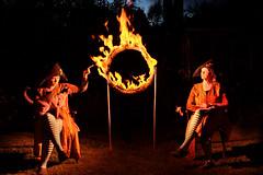 Burning Hoop of Doom (Apionid) Tags: flaminghoop fire circus trick dark clones moriarty werehere hereios nikond7000