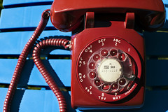 Red Phone (Curtis Gregory Perry) Tags: red telephone rotary dial phone western electric old vintage technology telecommunications cell smart antique retro blue nikon d810 50mm f12 cord handset base colorful 503 area code number call electronics shadow