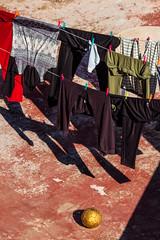 Sueños... (Eugercios) Tags: almuñecar granada clothes ropa balon ball oro golden play dream sueño dry wet españa espanha europe europa spain rooftop azotea terraza sol sun