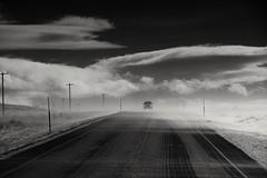 vanishing point... (Alvin Harp) Tags: december 2015 oregon us95 jordanvalley rome icyroads winterroad isolation telephonepoles blackandwhite monochrome bwwinter bw sonyilce7rm2 fe24240mm alvinharp
