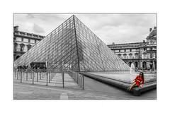 La jeune femme en rouge (jldum) Tags: youngwoman woman red pyramide louvre paris france bw architecture art artiste artist sonyflickraward