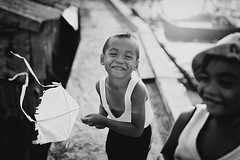 BS0I0353 (jeridaking) Tags: kite flyer fly portrait people children boy toy mono monotone black white outrigger sky sea boat fisherman guiuan samar visayas canon 35mm 14 1dxii reflection folks filipino pilipinas philippines
