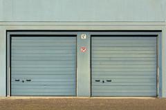 Two blue garage doors (Jan van der Wolf) Tags: map173266v blue doors deuren garage garages blauw gevel symmetric symmetry symmetrie