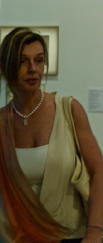 A Phographer MISTAKE: when trying to capture the legend of a painting piece (cropped) captures a museum visitor
