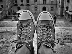 Crisscrossed ! (CJS*64) Tags: converse feet shoes resting laced laces cjs64 craigsunter cjs girona spain blisters dslr d7000 blackwhite bw blackandwhite whiteblack whiteandblack mono monochrome cathedral forçavella 24mm85mmlens nikon nikkorlens nikkor