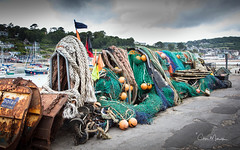 Fishing Stuff (clive_metcalfe) Tags: net float flag fishing lymeregis dorset coast rope harbour trawldoors