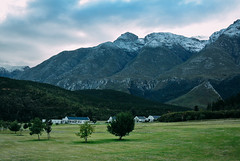 Gaiko Lodge with snow capped mountains (Atelier Design Studio) Tags: swellendam overberg snow snowing peaks marlothnaturereserve marloth holiday winter mountains mountain clock 11oclockpeak 12oclockpeak 1oclockpeak twofeathershorsetrails walk hiking familyhike cold countrylife gaikoulodge walking hikers atelierdesignstudio royaltyfree snowcapped langeberg country countryliving weekend forest green