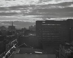 Glasgow evening light (OhDark30) Tags: olympus 35rc 35 rc film 35mm monochrome bw blackandwhite bwfp fuji neopan acros 100 rodinal glasgow evening buildings street roofs clouds outline lowsun city urban