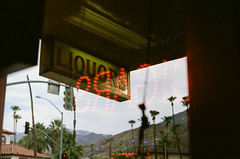 Liquor and Cigars (eekim) Tags: locomotiveliquor palmsprings canonexee fujifilmpro400h reflection film yxyy california unitedstates us