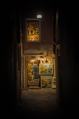 Magic in the alley (JDWCurtis) Tags: art artistic paint paintings painting shop selling artseller alley alleyway dark night nightlight nightlights lamp artwork venice venezia italy italian tourism solo solotraveller soloholiday