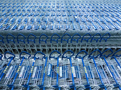 Parked (arbyreed) Tags: arbyreed blue metal metalic carts shoppingcarts ikea stacked stored parked shopping retail retailshopping store brickandmorterstore