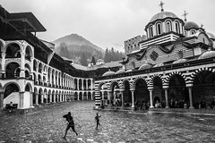 RUN (taxtamas) Tags: monochrome blackandwhite kids run rila monastery unesco world heritage architecture rain raining runnung building orthodox church mountain