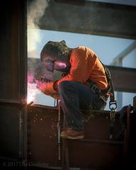 Molten (Lisa Ouellette) Tags: gloves slag sparks helmet smokeflux backerrod welding momentframe construction harness mask steel sjgh leather lanyard