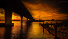 Urban Beauty (JDS Fine Art Photography) Tags: sunset bridge landscape water beach urbanlandscape urban inspirational beauty urbanbeauty lines clouds dramaticsunset dramatic city architecture