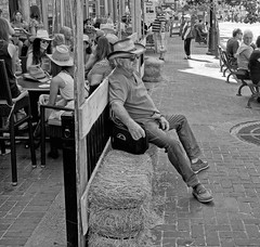 Calgary Stampede, Downtown Action (Sherlock77 (James)) Tags: calgary downtown stephenavenue streetphotography people patio bar man cowboyhat